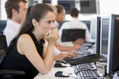 Woman Looking At Monitor - stock photo