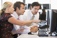 Stock Trader Team At Work - stock photo