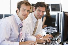 Colleagues Working Together At Computer - stock photo