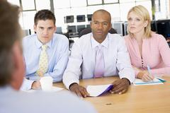 Stock Traders Conducting Interview - stock photo