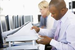 Stock Trader Looking Though Paperwork Stock Photos