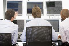Stock Traders Viewing Monitors Stock Photos