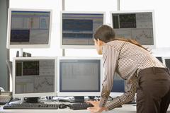 Stock Trader Examining Computer Monitors - stock photo