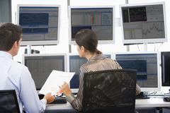 Stock Traders Viewing Monitors Stock Photos