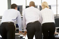 Stock Traders Viewing Monitors - stock photo