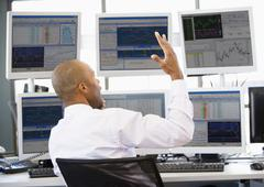 Stock Trader Talking Animatedly On The Phone - stock photo