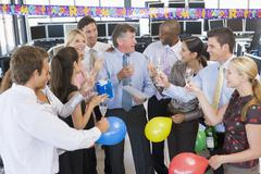 Stock Traders Celebrating In The Office Stock Photos