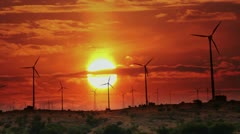 Wind farm - turning windmills against timelapse sunrise Stock Footage