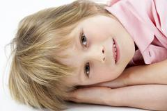 Boy Laying on Stomach - stock photo