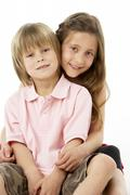 Two Children Sitting with each other in Studio - stock photo
