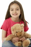 Studio Portrait Of Smiling Girl with Teddy Bear - stock photo