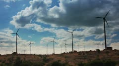 wind farm - turning windmills against timelapse clouds - stock footage