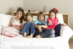 Young Children Watching Television at Home Stock Photos