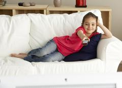 Young Girl Watching Television at Home Stock Photos