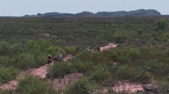 Horseback riders on dirt road in Texas landscape Stock Footage