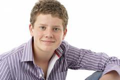 Studio Portrait of Smiling Teenage Boy - stock photo