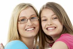 Studio Portrait of Smiling Teenage Girl with older Sister Stock Photos