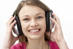 Portrait of Smiling Teenage Girl Listening to Music Stock Photos