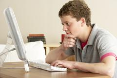Teenage Boy in Thought Studying at Home Stock Photos