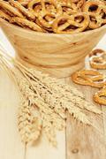 Pretzels and wheat. vertical shot, shallow depth of field. Stock Photos