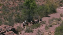 Mounted riders in rugged Texas landscape Stock Footage