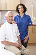 Portrait of male and female osteopath - stock photo