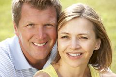 Close up of middle aged couple outdoors - stock photo