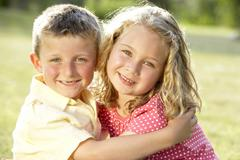 2 Children hugging outdoors Stock Photos