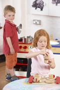 Two Young Children Playing Together at Montessori/Pre-School - stock photo