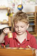 Young Boy Playing at Montessori/Pre-School - stock photo