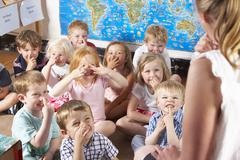 Montessori/Pre-School Class Listening to Teacher on Carpet Stock Photos