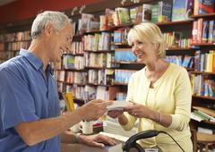 Male customer in bookshop Stock Photos