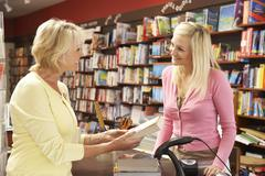Stock Photo of Female customer in bookshop