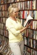 Female customer in bookshop - stock photo