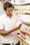 Male customer buying herbal tea - stock photo