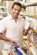 Male customer buying herbal tea Stock Photos