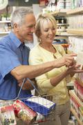 Middle aged couple buying herbal tea - stock photo