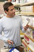 Stock Photo of Male customer buying herbal tea
