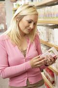 Stock Photo of Female customer buying herbal tea