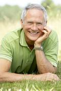 Portrait of mature man relaxing in countryside Stock Photos