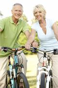 Stock Photo of Mature couple riding bikes