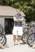 Stock Photo of Owner of cycle shop in workshop