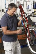 Owner of cycle shop in workshop Stock Photos