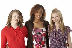 portrait of three teenage girls - stock photo