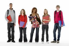 Full length studio portrait of five teenage students Stock Photos