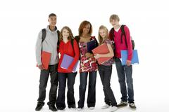full length studio portrait of five teenage students - stock photo