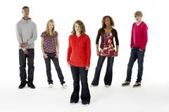 Stock Photo of full length studio portrait of five teenage friends