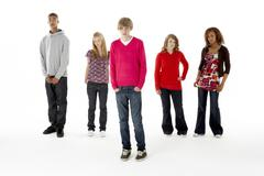 Full length studio portrait of five teenage friends Stock Photos