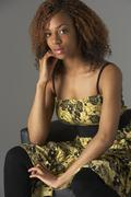 studio portrait of fashionably dressed teenage girl - stock photo