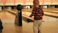 Young toddler bowling Stock Footage